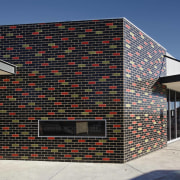 A variety of brick surfaces is achievable, says architecture, building, commercial building, facade, house, real estate, residential area, structure, black, gray