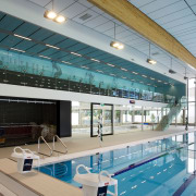 New school centre with pool, fitness centre, health architecture, daylighting, glass, leisure, leisure centre, sport venue, structure, swimming pool, gray