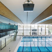 The 34m-long laminated beams over the main pool apartment, architecture, ceiling, condominium, daylighting, estate, leisure, leisure centre, real estate, roof, structure, swimming pool, gray