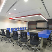 The McCann Worldgroup boardroom table has a blue, auditorium, ceiling, conference hall, interior design, office, gray