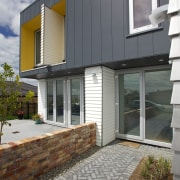 Linea® Weatherboards and Stria® Cladding offer heavy-duty performance architecture, building, elevation, facade, home, house, property, real estate, residential area, siding, window, gray