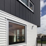 Doors and windows in this Ideal House were architecture, building, commercial building, elevation, facade, home, house, real estate, residential area, siding, window, black, gray, white