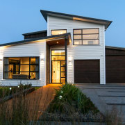 This Shore Homes show home has a strong architecture, building, elevation, facade, home, house, property, real estate, residential area, siding, window, black, teal