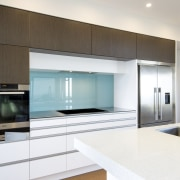 The white semi-gloss lacquered cabinets in this kitchen cabinetry, countertop, home appliance, interior design, kitchen, real estate, white