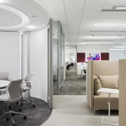 Circular meeting rooms in this office interior in ceiling, interior design, office, product design, gray