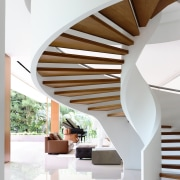 A sculptural staircase is a defining part of architecture, ceiling, daylighting, estate, home, house, interior design, product design, stairs, wood, white