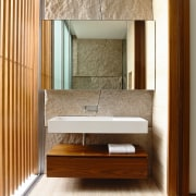 This guest bathroom features a split-granite wall, which floor, flooring, furniture, interior design, wall, wood, wood flooring, brown, white