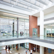 This lobby and the common room share the architecture, building, daylighting, interior design, lobby, mixed use, shopping mall, tourist attraction, white, gray
