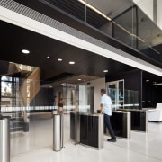 A black ceiling creates an intimate entry for glass, interior design, lobby, black, white