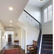 A wide-plank, tongue-and-groove solid oak floor in the architecture, ceiling, daylighting, estate, floor, handrail, home, house, interior design, real estate, stairs, structure, window, gray