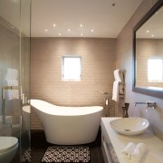 Italian-made tiles were chosen for the bathrooms in architecture, bathroom, ceiling, daylighting, floor, home, interior design, plumbing fixture, product design, room, sink, gray
