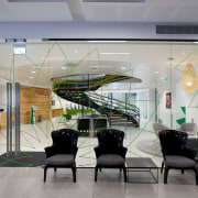 Green graphics on the glass walls of the ceiling, glass, interior design, lobby, gray