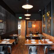 Steel lattice screens help to make the dining café, ceiling, dining room, interior design, restaurant, table, black