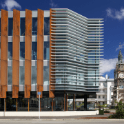 The contemporary detailing on this new Christchurch building, apartment, architecture, building, city, commercial building, condominium, corporate headquarters, daytime, downtown, facade, headquarters, hotel, metropolis, metropolitan area, mixed use, neighbourhood, property, real estate, residential area, skyscraper, tower block, urban area