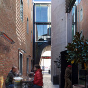 Contemporary commercial building in Christchurch with laneway bars alley, apartment, architecture, building, city, facade, house, neighbourhood, road, street, town, window, gray, black