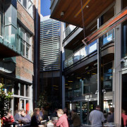 Sunlight filters into the Stranges laneway by day. building, café, city, downtown, house, mixed use, neighbourhood, black