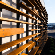 The cedar screen on this new funeral home architecture, building, condominium, daylighting, facade, line, lumber, sky, wood, black