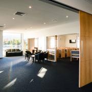 Large timber veneer sliding doors in the Harbour ceiling, floor, flooring, interior design, lobby, office, real estate, white