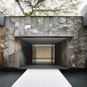 This entry to a room on the lower architecture, facade, home, house, interior design, lobby, wall, black, white, gray