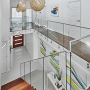 A cantilevered staircase appears to float in the countertop, interior design, kitchen, product design, gray