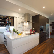 A large cavity door opens up a scullery countertop, interior design, kitchen, real estate, room, gray, brown