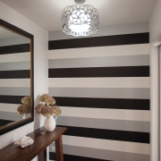A dramatic striped wallpaper defines the entry to ceiling, door, home, interior design, room, wall, window, window covering, gray