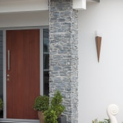 The entry to this new GJ Gardner Homes architecture, facade, home, house, siding, structure, window, gray, white