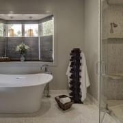 Textural white rock features on the floor of bathroom, floor, flooring, home, interior design, plumbing fixture, room, tile, window, gray