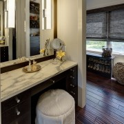 A makeup vanity at the entry to the countertop, floor, flooring, interior design, kitchen, room, black, gray