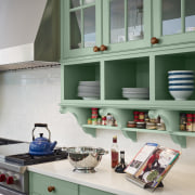 This china display and under-counter cabinetry is painted cabinetry, countertop, kitchen, room, shelf, shelving, window, green