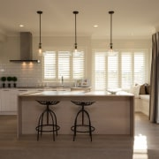 High-gloss cabinetry is teamed with limewashed American Oak cabinetry, countertop, cuisine classique, floor, flooring, interior design, kitchen, real estate, room, window, wood flooring, brown