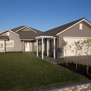 The new Landmark Homes Brookside show home in building, cottage, elevation, estate, facade, farmhouse, grass, home, house, landscape, lawn, property, real estate, residential area, roof, siding, suburb, window, yard, brown, teal