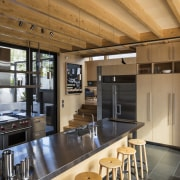 This new semi-industrial kitchen features a birch timber architecture, ceiling, countertop, house, interior design, kitchen, real estate, orange, brown