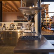 This new Arclinea kitchen has a U shape, countertop, cuisine classique, interior design, kitchen, brown