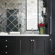 While the lacquered maple vanity in this master bathroom, bathroom accessory, bathroom cabinet, interior design, sink, black, white