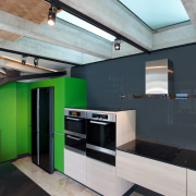A black glass splashback and black quartz stone architecture, ceiling, daylighting, house, interior design, product design, gray, black