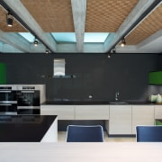 A black glass splashback and black quartz stone architecture, ceiling, daylighting, house, interior design, black