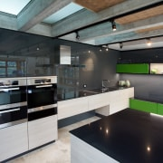 In this new Poggenpohl kitchen black glass and countertop, interior design, kitchen, loft, black, gray