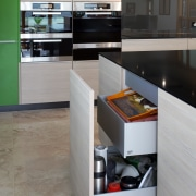 This kitchen island includes contemporary storage solutions. countertop, floor, interior design, kitchen, product design, gray, black