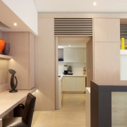 A sliding door to a second kitchen in architecture, ceiling, floor, flooring, house, interior design, lobby, product design, white, orange