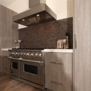 Tall cabinets frame the cooking zone in this cabinetry, countertop, cuisine classique, floor, flooring, hardwood, home appliance, interior design, kitchen, kitchen appliance, kitchen stove, tile, wood flooring, gray, brown, black