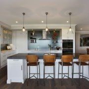 A dark splashback, charcoal grey island benchtop and cabinetry, countertop, cuisine classique, interior design, kitchen, real estate, room, gray