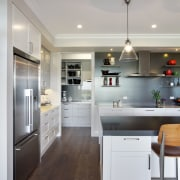 The open door to the scullery shows that cabinetry, countertop, cuisine classique, floor, flooring, home appliance, interior design, kitchen, room, wood flooring, gray