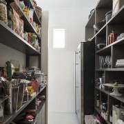 The walls of this scullery are lined with bookcase, closet, interior design, room, shelf, shelving, white, black