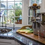 In this new kitchen by Elina Katsioula-Beall, a countertop, home, interior design, kitchen, window, gray