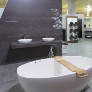 Freestanding tubs, vessel basins and bathroom accessories are architecture, bathroom, ceramic, floor, flooring, interior design, plumbing fixture, product design, sink, tap, tile, gray