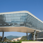 A ribbon of offices wraps the Zhuhai International architecture, building, commercial building, condominium, convention center, corporate headquarters, daylighting, daytime, facade, headquarters, metropolitan area, mixed use, sky, teal