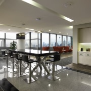 Breakout spaces and work desks are positioned by ceiling, interior design, property, real estate, table, gray