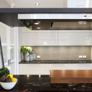 Positioning the main work area so it faces countertop, glass, interior design, kitchen, gray, black