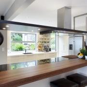 A warm brown stain on this oak bar countertop, interior design, kitchen, gray